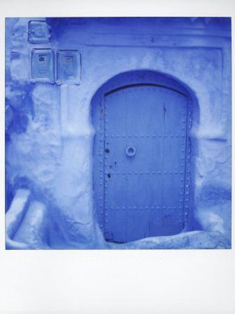 lee-frost-polaroid-of-traditional-painted-blue-door-against-bluewashed-wall-chefchaouen-morocco