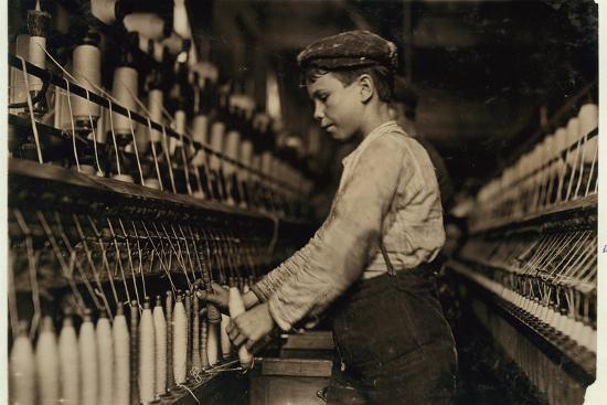 lewis-wickes-hine-a-doffer-replaces-full-bobbins-at-globe-cotton-mill-augusta-georgia-1909