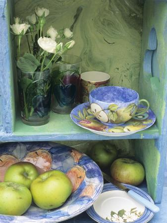 linda-burgess-coffee-cup-flowers-and-bowl-of-apples-on-shelves