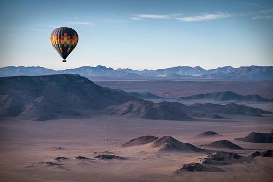 liz-glasco-colorful-hot-air-balloon-flying-over-the-high-mountains-in-namibia-high-altitude-namibia-south