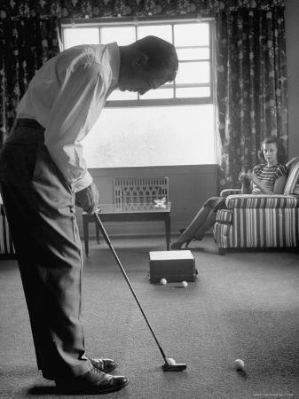loomis-dean-golfer-ben-hogan-practicing-putting-in-his-town-house-with-wife-valerie-watching-from-armchair
