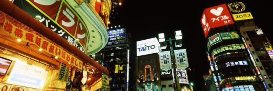 low-angle-view-of-buildings-lit-up-at-night-shinjuku-ward-tokyo-prefecture-kanto-region-japan