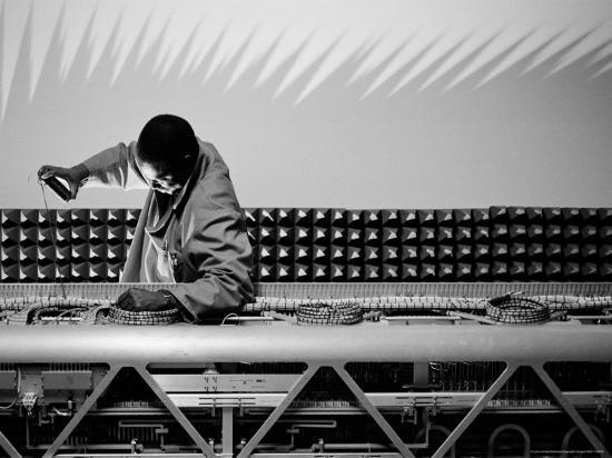 lynn-johnson-technician-secures-cables-on-a-sophisticated-piece-of-equipment
