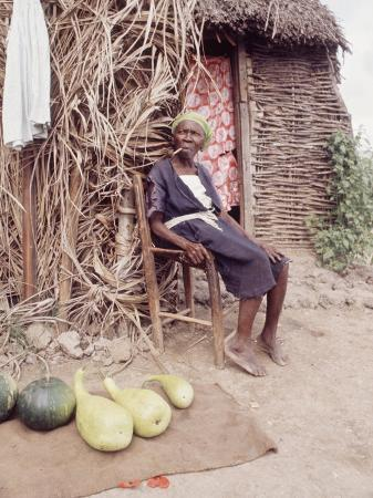 lynn-pelham-old-haitian-woman-in-front-of-her-hut