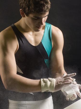 male-gymnast-putting-chalk-on-his-hands-bainbridge-island-washington-state-usa