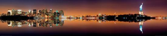 manhattan-new-york-city-skyline-with-statue-of-liberty-at-night