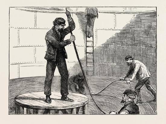 manufacturing-an-electric-telegraph-cable-coiling-down-the-cable-in-the-tank-1873