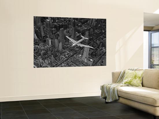 margaret-bourke-white-aerial-view-of-a-dc-4-passenger-plane-flying-over-midtown-manhattan