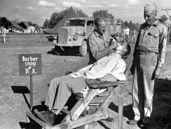 margaret-bourke-white-american-quartermaster-corpsman-john-ralford-designer-of-th-wooden-barber-chair