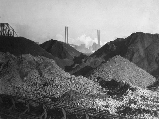 margaret-bourke-white-huge-heaps-of-iron-ore-outside-steel-plant-brought-in-by-shipping-along-the-great-lakes
