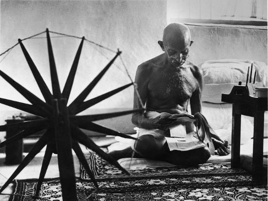 margaret-bourke-white-indian-leader-mohandas-gandhi-reading-as-he-sits-cross-legged-on-floor