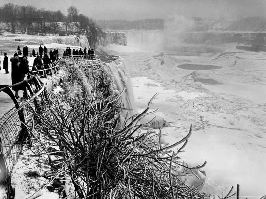margaret-bourke-white-view-of-visitors-watching-ice-formations-at-the-american-side-of-a-frozen-niagara-falls