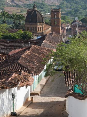 margie-politzer-cobblestone-street-with-colonial-houses-and-catedral-de-la-inmaculada-concepcion-in-background