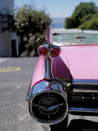 mark-chivers-close-up-of-fin-and-lights-on-a-pink-cadillac-car
