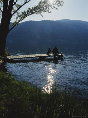 mark-cosslett-man-and-his-dog-on-a-lake-skaha-dock