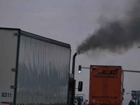 mark-thiessen-diesel-truck-belching-exhaust-from-it-s-smokestack-at-a-truckstop