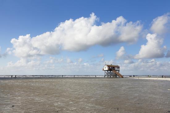 markus-lange-stilt-houses-on-a-beach