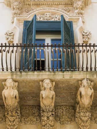 martin-child-baroque-balcony-palazzo-nicolaci-noto-sicily-italy-europe