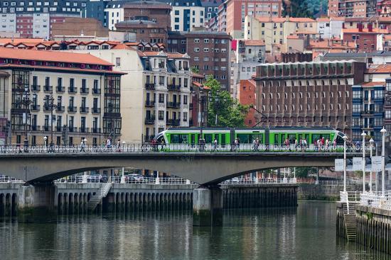 martin-child-tram-crossing-the-river-nervion-in-bilbao-biscay-vizcaya-basque-country-euskadi