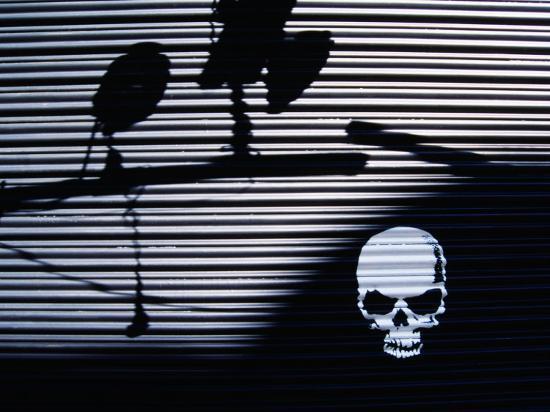 martin-moos-graffiti-and-shadows-of-street-lamps-on-garage-shutter-door-tokyo-japan