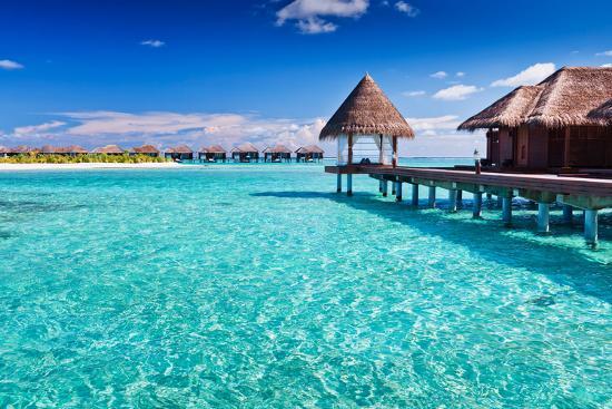 martin-valigursky-overwater-spa-in-blue-lagoon-around-tropical-island