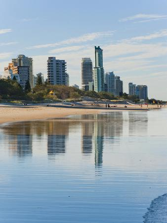 matthew-williams-ellis-reflections-of-high-rise-buildings-at-surfers-paradise-beach-gold-coast-queensland-australia