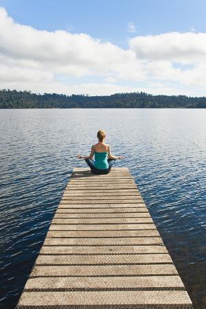matthew-williams-ellis-woman-meditating-on-a-jetty-lake-ianthe-west-coast-south-island-new-zealand-pacific