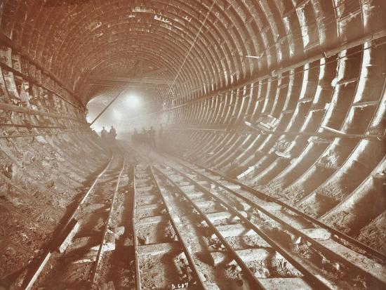 men-pushing-railway-trucks-along-the-rotherhithe-tunnel-stepney-london-june-1907