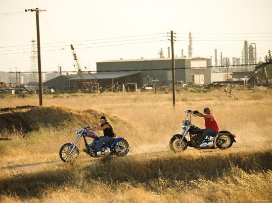 men-riding-custom-motorcycles-on-dusty-road