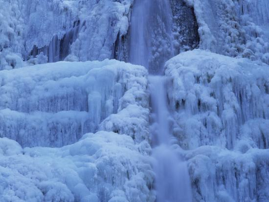 michael-busselle-waterfall-iced-over-in-winter-in-franche-comte-france-europe