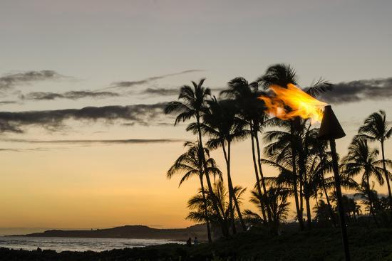michael-defreitas-tiki-torches-at-sunset-on-poipu-beach-kauai-hawaii