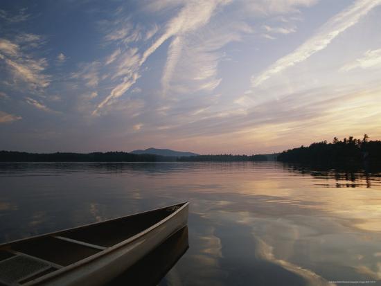 michael-melford-canoe-on-the-lower-st-regis-lake-at-sunset