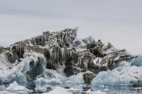 michael-nolan-iceberg-with-moraine-material-and-icicles-at-booth-island-antarctica-polar-regions