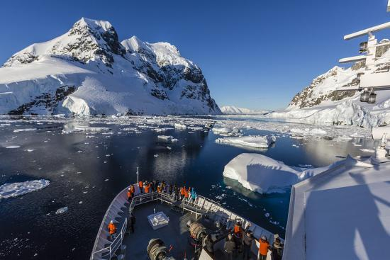 michael-nolan-the-lindblad-expeditions-ship-national-geographic-explorer-in-the-lemaire-channel-antarctica