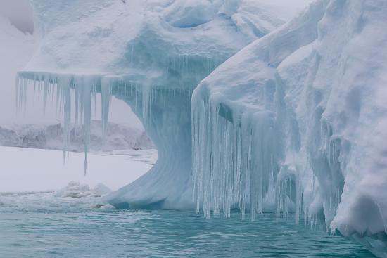 michael-nolan-wind-and-water-sculpted-iceberg-with-icicles-at-booth-island-antarctica-polar-regions