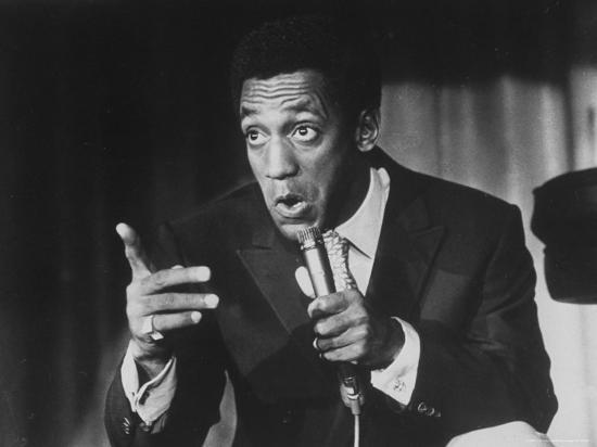 michael-rougier-comedian-bill-cosby-holding-mike-as-he-performs-on-stage