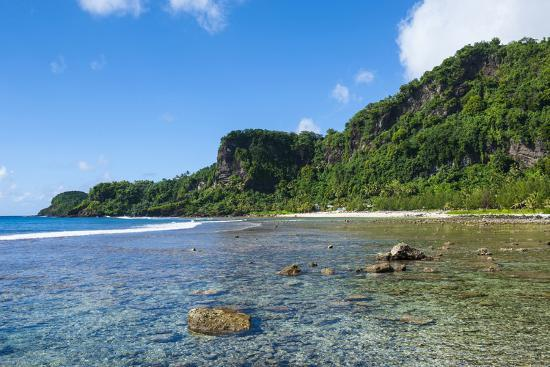 michael-runkel-bay-and-turquoise-water-in-tau-island-manu-a-american-samoa-south-pacific