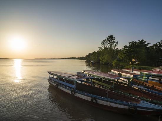 michael-runkel-fishing-boats-at-sunset-on-the-suriname-river-near-paramaribo-surinam-south-america