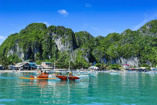 michael-runkel-the-bay-of-el-nido-with-outrigger-boats-bacuit-archipelago-palawan-philippines