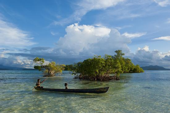michael-runkel-young-boys-fishing-in-the-marovo-lagoon-before-dramatic-clouds-solomon-islands-south-pacific