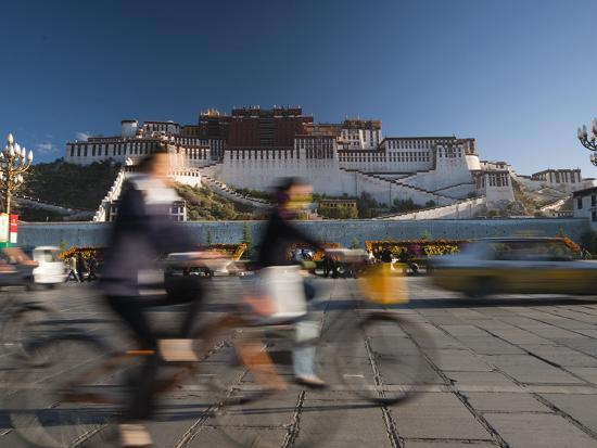 michael-s-yamashita-bicyclists-and-traffic-in-front-of-the-potala-palace