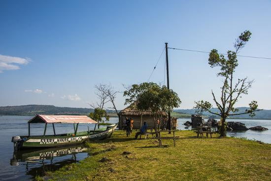 michael-tourist-boat-anchoring-on-a-little-island-at-the-source-of-the-nile
