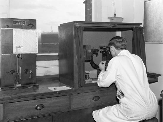 michael-walters-a-lab-tachnician-with-a-reichter-microscope-at-a-steelworks-sheffield-south-yorkshire-1962