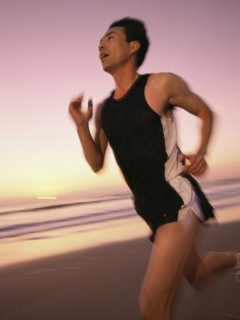 mid-adult-man-jogging-on-the-beach