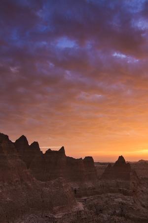 mike-cavaroc-clouds-reflect-color-over-badlands-national-park-south-dakota-at-sunrise
