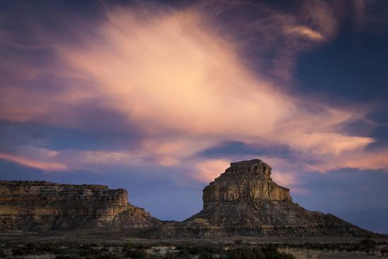 mike-cavaroc-sunset-casts-a-pink-glow-on-clouds-above-fajada-butte-fajada-gap-in-chaco-culture-nhp-new-mexico