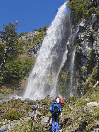 mike-theiss-hikers-find-a-waterfall-of-ice-and-snow-melt-from-the-andes-mountains