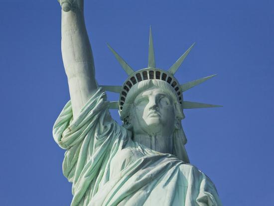 mike-theiss-statue-of-liberty-against-a-clear-blue-sky