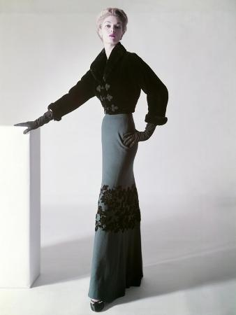 model-jean-patchett-in-a-sealskin-mainbocher-jacket-and-full-length-skirt-with-velvet-flowers