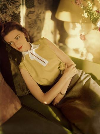 modeling-wearing-a-gold-irish-linen-sleeveless-blouse-buttoned-in-the-back-by-sidney-heller